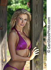 Blonde Bikini Model - A blonde bikini model posing outdoors...