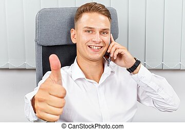 Confident businessman in office - Handsome young businessman...