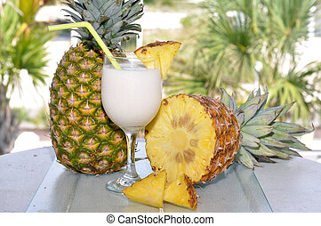 Pina Colada with Pineapple - Pina Colada on table with whole...
