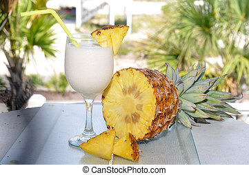 Pina Colada with Pineapple - Pina Colada on table with...