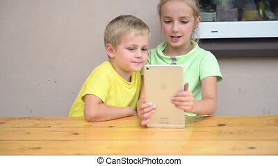 kids playing with tablet - two kids playing with tablet