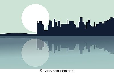 Silhouette of city and reflection with full moon
