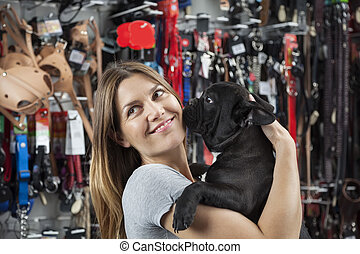 Customer Looking Away While Carrying French Bulldog In Store...