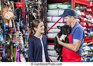 Girl Looking At Salesman Carrying French Bulldog - Happy...