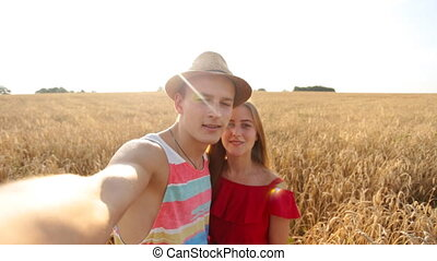 Happy young couple taking selfie by mobile phone