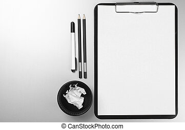 Office supplies on desk - Black and white stationery on gray...