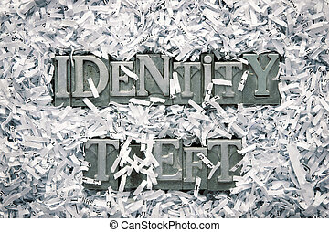 identity theft phrase made from metallic letterpress type...