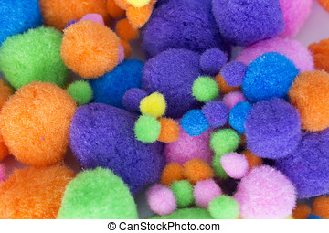 Fluffy colorful craft Pom Poms - This is a photograph of...