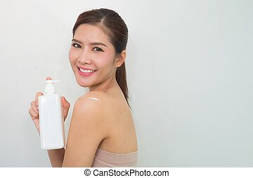 Body lotion, Portrait of Beautiful Young Woman looking at Camera. Beautiful Asian female model on Whitebackground with clipping path.