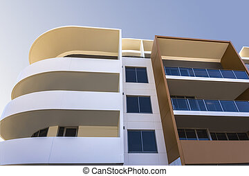 Low angle view of a modern building with floors and round...