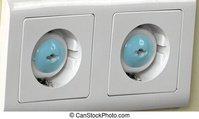 Hand remove safety plugs in electricity socket on wall baby...