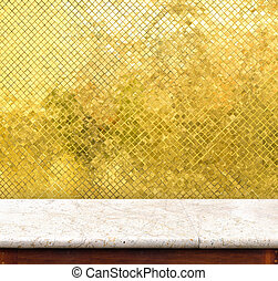Empty marble table and golden tiles wall in...
