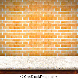 Empty marble table and orange brick wall in...