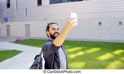 man taking video or selfie by smartphone in city 32 -...