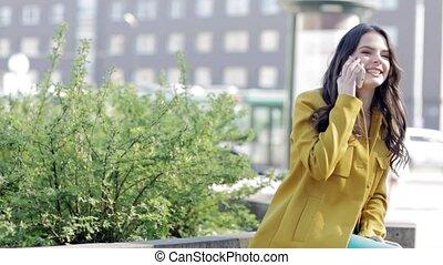happy woman or teenage girl calling on smartphone -...