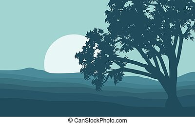 Silhouette of single tree and moon