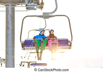 Extreme sports - Young couple in sportswear on a lift