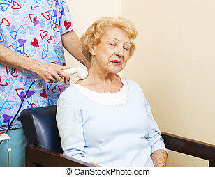 Ultrasound for Neck Pain - Senior chiropractic patient gets...