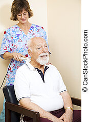Ultrasound Therapy Relief - Senior chiropractic patient gets...