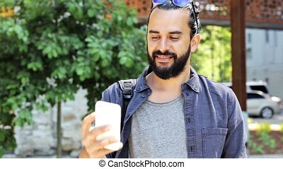 man taking video or selfie by smartphone in city 42 -...
