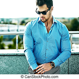 Fashion portrait of young sexy handsome model man in casual...