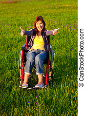 Handicapped woman on wheelchair - Happy handicapped woman...