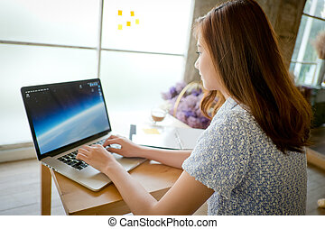 The Beautiful business woman using a laptop computer