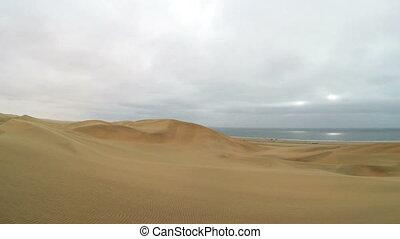 Namib Desert meets the Atlantic Ocean. Dunes of the Namib...