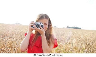 Woman with retro camera - Portrait happy pretty blonde woman...