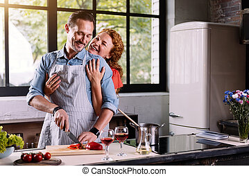 Woman hugging man from the back - Cooking like a hobby...