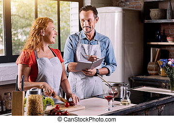 Woman and man in the kitchen - Happy day. Mature man...