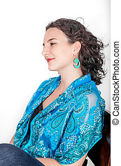Young woman with aqua shawl on white. - Young model in her...