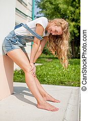 girl against a wall and fooled laugh - she leaned against...