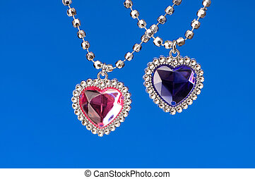 Silver pendant isolated on the colourful background