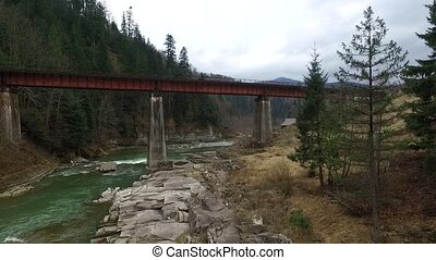 beautiful landscape of bridge over mountain river in...