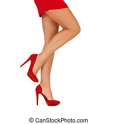 close up of woman legs in red high heeled shoes
