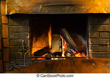 close up of burning fireplace at home - stove heating and...