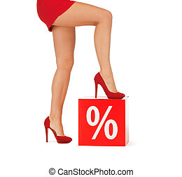close up of woman in red shoes with percent sign