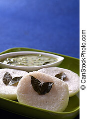 Idli with coconut chutney on blue background, Indian Dish :...
