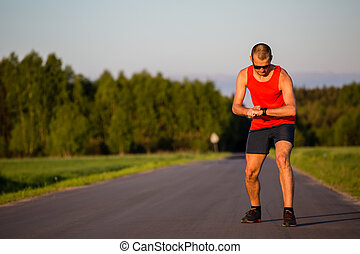 Man running on country road and training