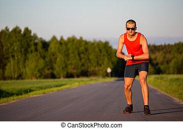 Man running on country road training - Man runner running on...