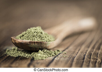 Heap of Stevia (powder) on an old wooden table (close-up...