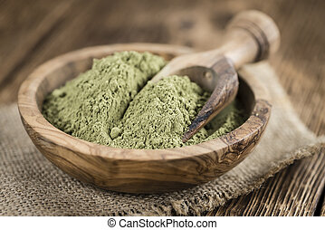 Heap of Stevia powder on an old wooden table close-up shot...