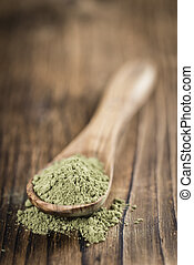 Stevia leaf powder (detailed close-up shot) on rustic wooden...