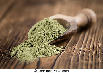 Portion of Stevia leaf powder (detailed close-up shot) on...