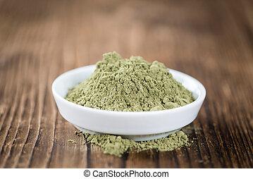 Portion of Stevia leaf powder (detailed close-up shot) on...