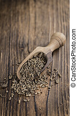 Dried Valerian roots (detailed close-up shot) on wooden...