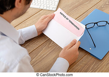 Notice of job termination - Fired business man reads the...