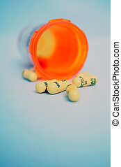 Perscription drugs - Closeup shot of some pills spilled out...