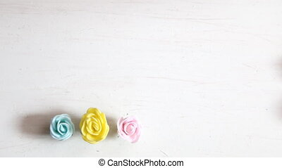 Lovely flowers on wooden background. Roses on a white table.